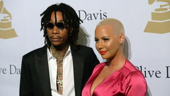BEVERLY HILLS, CA - FEBRUARY 11:  Musician Wiz Khalifa (L) and Amber Rose walk the red carpet at Clive Davis annual Pre-Grammy Gala at The Beverly Hilton Hotel on February 11, 2017 in Beverly Hills, California.  (Photo by Scott Dudelson/Getty Images)