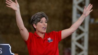 "U.S. senator Joni Ernst (R-IA) waves before Republican nominee Donald Trump at ""Joni's Roast and Ride"" in Des Moines, Iowa, U.S., August 27, 2016.   REUTERS/Carlo Allegri"