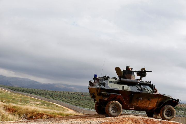 A Turkish soldier on an armored military vehicle patrols the border between Turkey and Syria, Nov. 1, 2016.