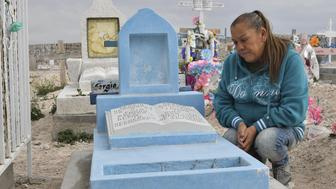 Maria Guadalupe Guereca, 60, visits the grave of her murdered son Sergio Hernandez at the Jardines del Recuerdo cemetery in Ciudad Juarez, Chihuahua, Mexico, during an interview with AFP on February 18, 2017. The shooting occurred June 7, 2010 while Sergio Hernandez was spending time with three friends on the banks of the Rio Grande, which separates Ciudad Juarez in Mexico from El Paso in Texas, US. Sergio was shot dead at 15 by police officer Jesus Mesa. This would have been another tale of tragic and banal violence, had the victim not been in Mexico and the perpetrator in the United States. / AFP / Yuri CORTEZ        (Photo credit should read YURI CORTEZ/AFP/Getty Images)