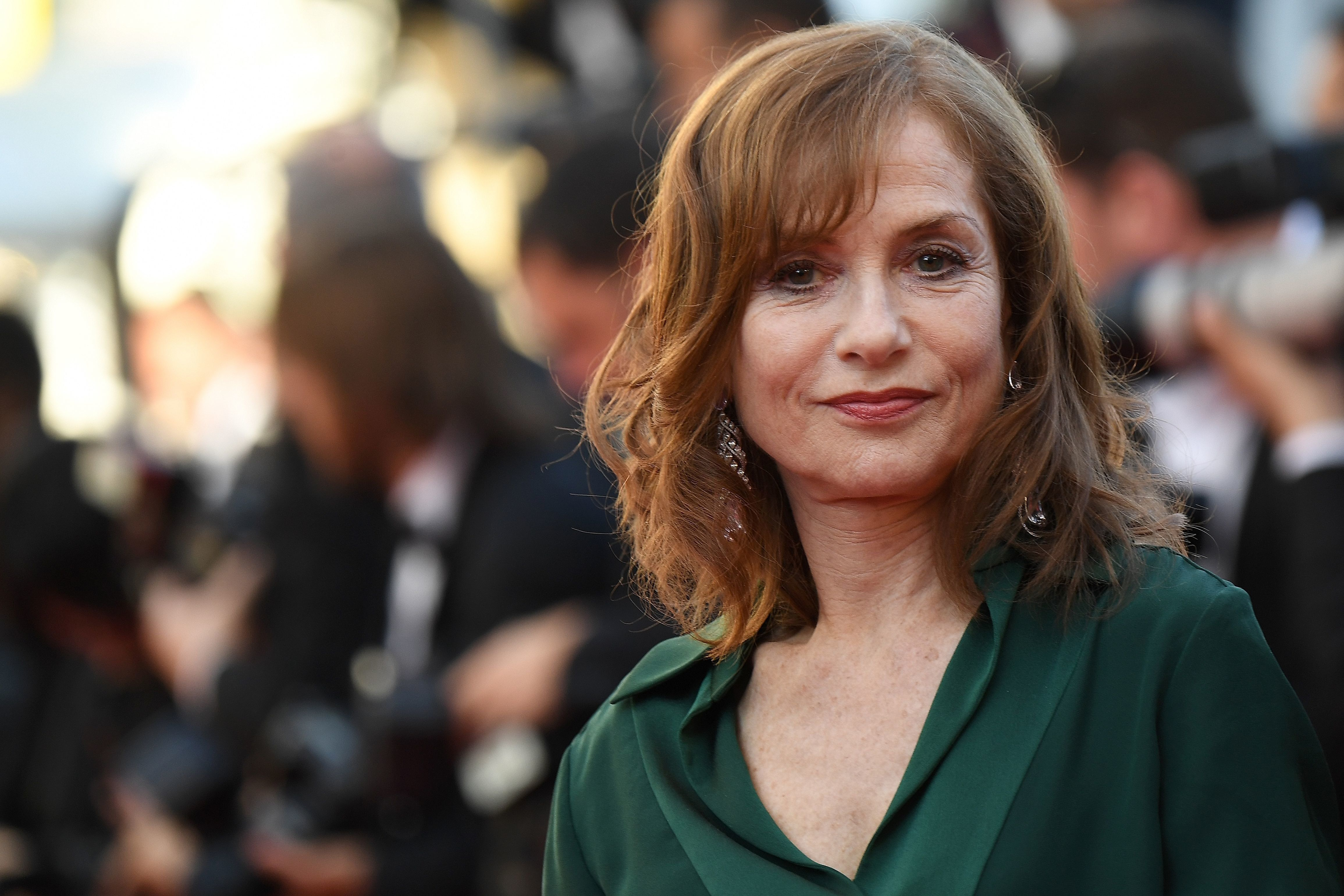 French actress Isabelle Huppert poses as she arrives on May 21, 2016 for the screening of the film 'Elle' at the 69th Cannes Film Festival in Cannes, southern France.  / AFP / ANNE-CHRISTINE POUJOULAT        (Photo credit should read ANNE-CHRISTINE POUJOULAT/AFP/Getty Images)