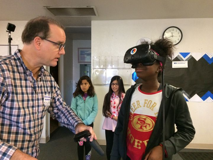 Jada Ikharo, a 5th grader at Lincoln Elementary in Manteca, gets a virtual reality lesson from Mark Andersen, co-founder of L