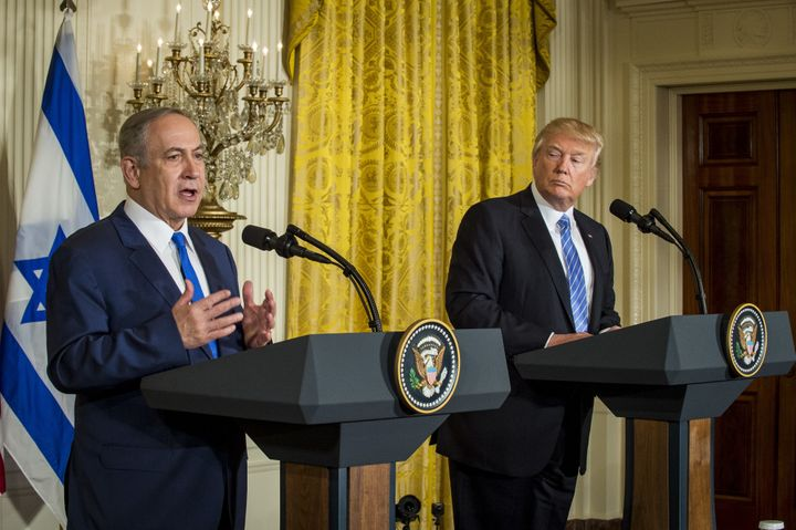 U.S. President Donald Trump listens while Benjamin Netanyahu, Israel's prime minister, speaks during a news conference at&nbs