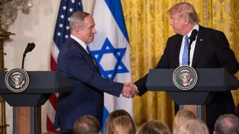 US President Donald Trump and Israeli Prime Minister Benjamin Netanyahu shake hands during a joint press conference in the East Room of the White House in Washington, DC, February 15, 2017. (Photo by Cheriss May/NurPhoto via Getty Images)
