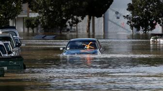 A vehicle is seen partially submerged in flood water after heavy rains overflowed nearby Coyote Creek in San Jose, California, U.S., February 21, 2017. REUTERS/Stephen Lam