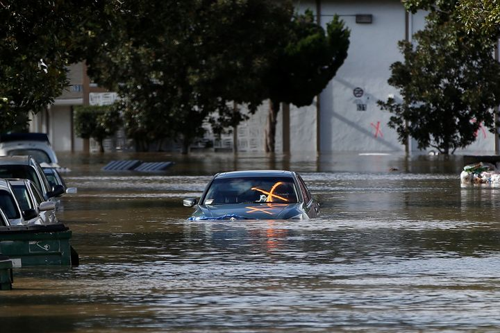 A vehicle is seen partially submerged in floodwater after heavy rains overflowed nearby Coyote Creek in San Jose.