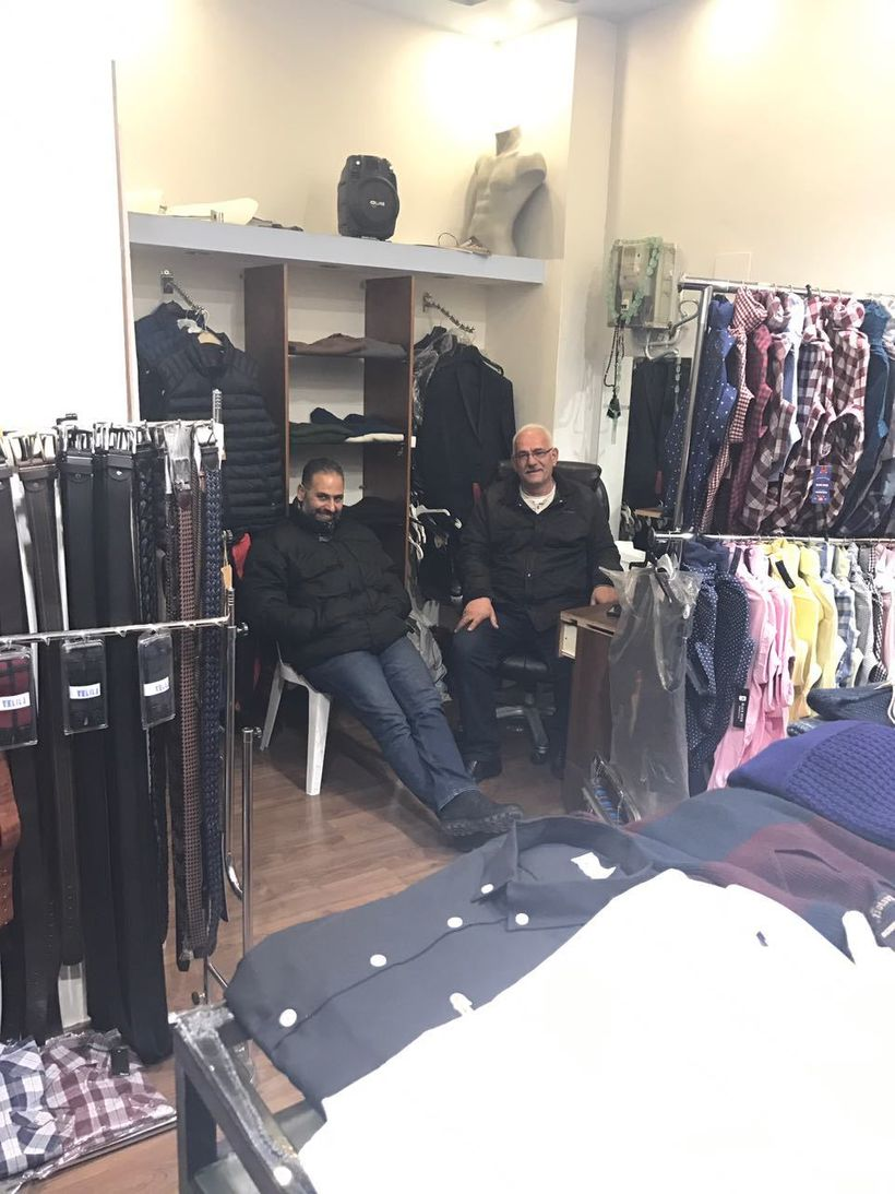 A shy George and Yacoub's father Yousef sends their regards from the fashion shop in Bethlehem