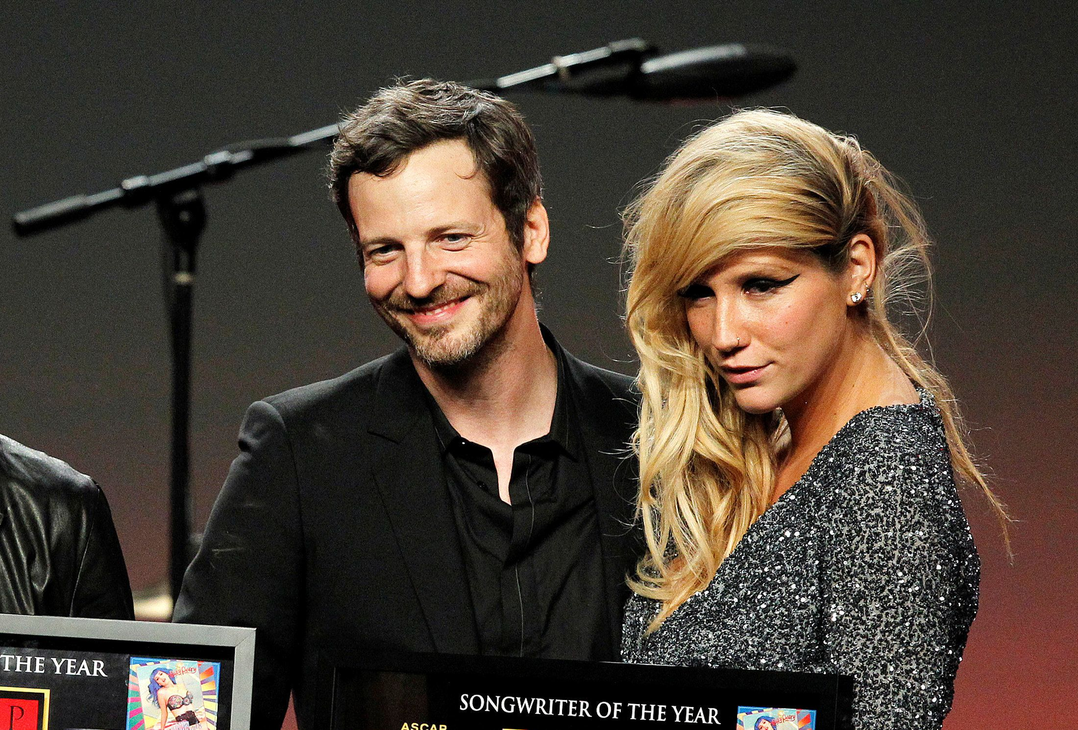 FILE PHOTO - Songwriter Lukasz Gottwald (L), better known as Dr. Luke, accept the Songwriter of the Year award from presenters Adam Lambert (not shown) and Kesha (R) at the 28th annual ASCAP (American Society of Composers, Authors and Publishers) Pop Music Awards in Hollywood, California, U.S. on April 27, 2011.  REUTERS/Mario Anzuoni/File Photo