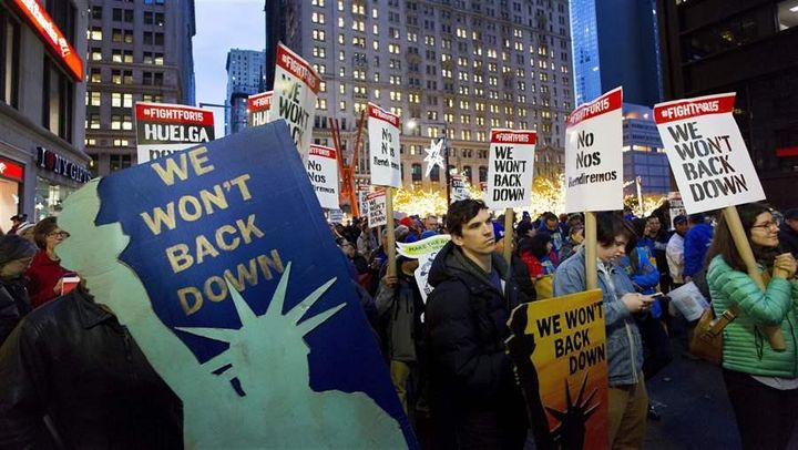 Workers seeking a higher minimum wage demonstrate in New York City in November. As more Americans work nontraditional jobs, d