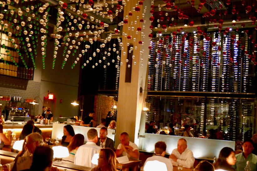 Main dining room has a temperature-controlled glassed off wall of 3,500 wine bottles