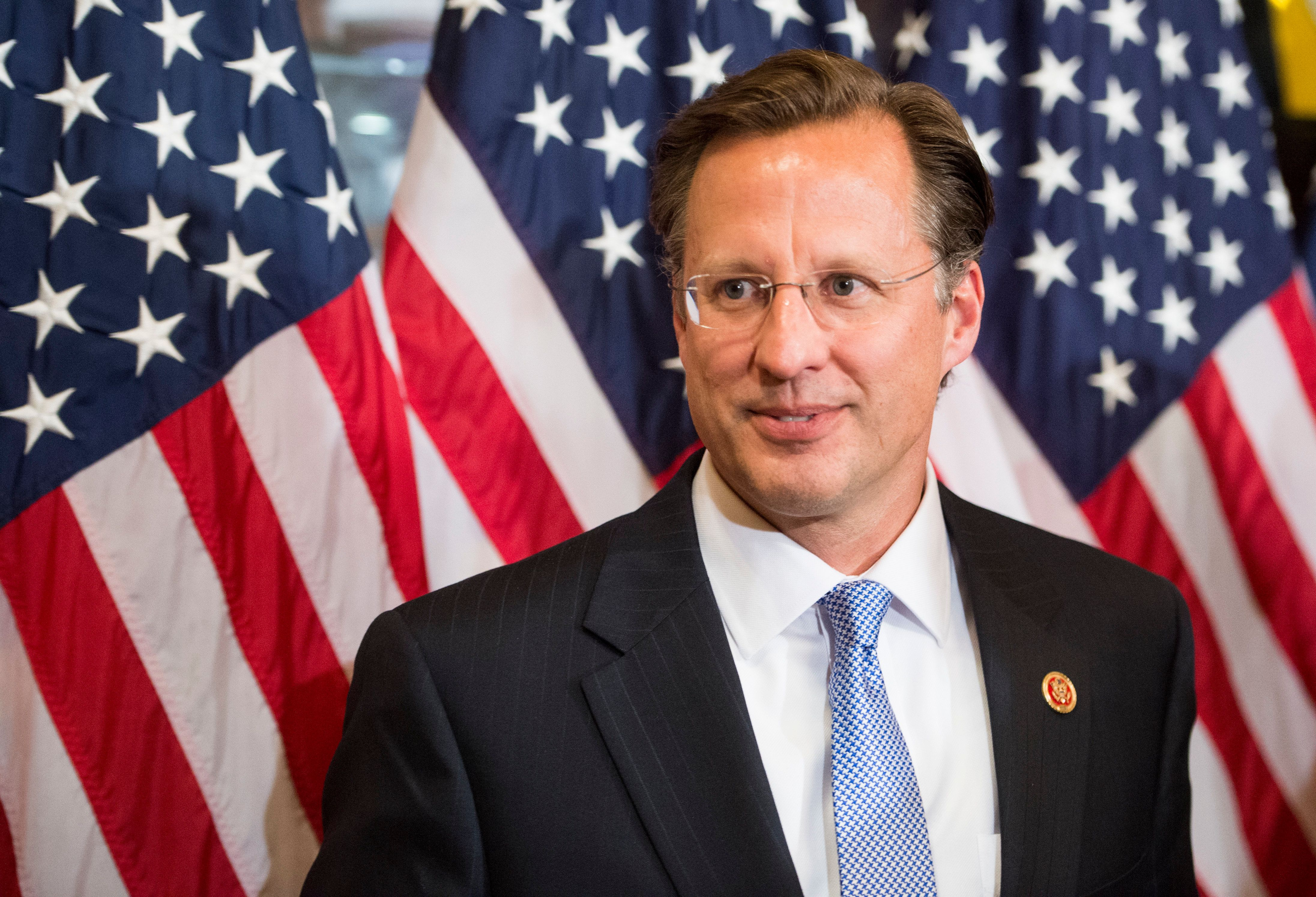 UNITED STATES - NOVEMBER12: Rep.-elect Dave Brat, R-Va., leaves the room following his ceremonial swearing-in photo-op with Speaker of the House John Boehner in the Capitol on Wednesday, Nov. 12, 2014. (Photo By Bill Clark/CQ Roll Call)