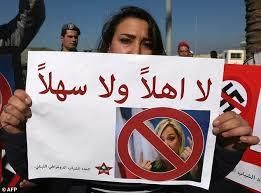 "A Lebanese protestor carries a poster saying: ""you are not welcome""."