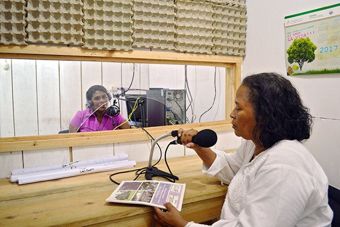 """<em>Communicadoras</em>, who are women's human rights defenders, record programming for the radio programme """"Voices of the Wo"""