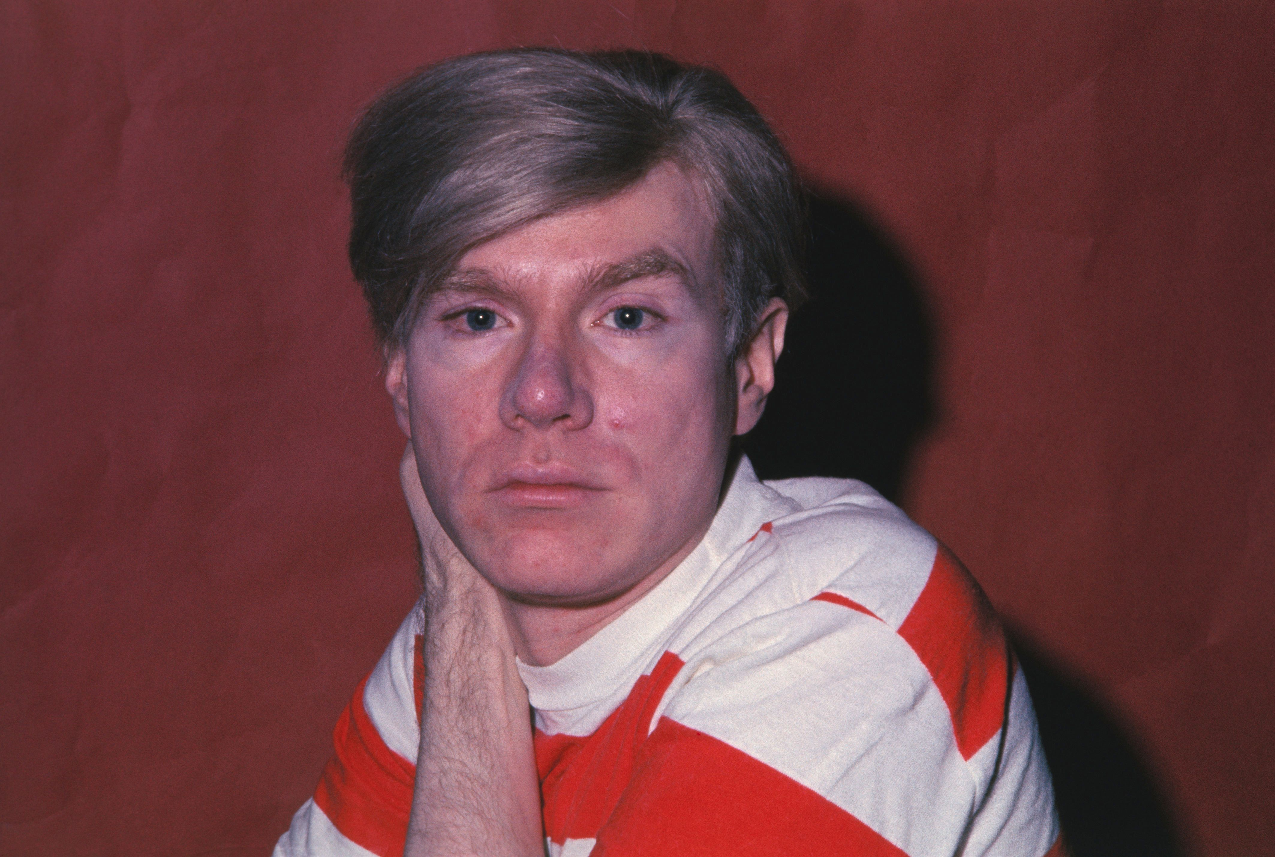 (Original Caption) Pop Artist Andy Warhol is shown posing for close up.