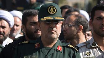 EDITORS' NOTE: Reuters and other foreign media are subject to Iranian restrictions on their ability to film or take pictures in Tehran.  Head of Iran's Revolutionary guards ground forces Mohammad Pakpour (C) attends a funeral ceremony in Tehran October 20, 2009. Fifteen members of Iran's Revolutionary Guards were among those killed in Sunday's suicide bombing in the Islamic Republic's volatile southeast, state radio reported on Tuesday. REUTERS/Morteza Nikoubazl (IRAN MILITARY POLITICS OBITUARY CONFLICT)