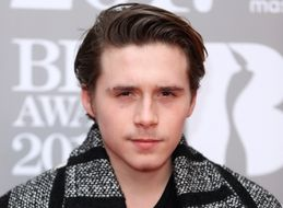 Brooklyn Beckham Hid His Snowboarding Injury Under A Burberry Coat At The Brit Awards