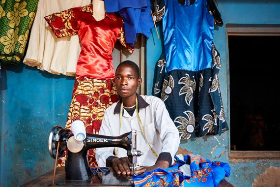 Lex Segwa, 22 years old, works on one of his dress designs at his tailoring workshop near Luchenza, southern Malawi.