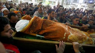 "Relatives, studients and friends of Omar Abdel-Rahman, the Muslim cleric known as ""The Blind Sheik"" who was convicted of conspiracy in the 1993 World Trade Center bombing in New York, carry his body at the funeral at the Grand Mosque at El Gamalia village in Mansoura city northo of in Cairo, Egypt February 22, 2017. REUTERS/Amr Abdallah Dalsh   ATTENTION EDITORS - VISUAL COVERAGE OF SCENES OF INJURY OR DEATH"