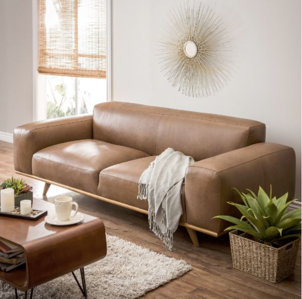"<strong>Dante Italian oxford tan leather sofa, $1,799.99, from <a href=""https://www.overstock.com/Home-Garden/Dante-Italian-O"