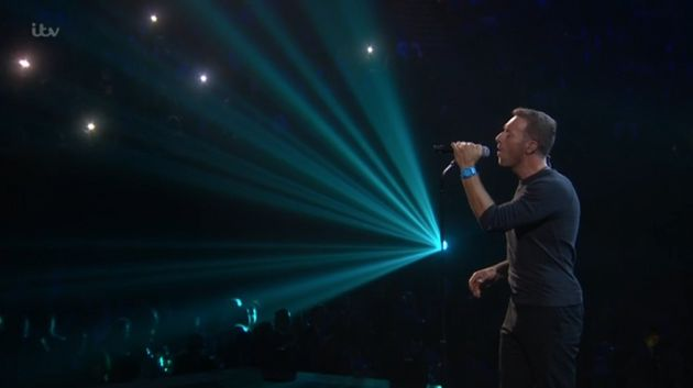 Chris Martin on stage at the