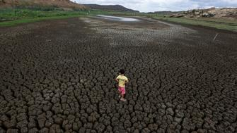 "Natan Cabral, 5, stands on the cracked ground of the Boqueirao reservoir in the Metropolitan Region of Campina Grande, Paraiba state, Brazil, February 13, 2017. REUTERS/Ueslei Marcelino             SEARCH ""BRAZIL DROUGHT"" FOR THIS STORY. SEARCH ""WIDER IMAGE"" FOR ALL STORIES."
