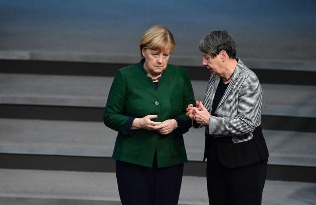 German Environment Minister Barbara Hendricks (right) talks with German Chancellor Angela Merkel (left).Hendrick's...