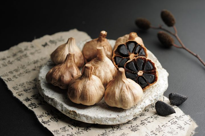 A plate of black garlic.