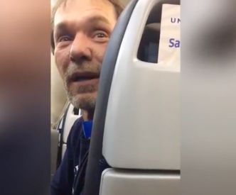 A man was escorted off a flight in front of a cheering crowd following accusations that he was being...