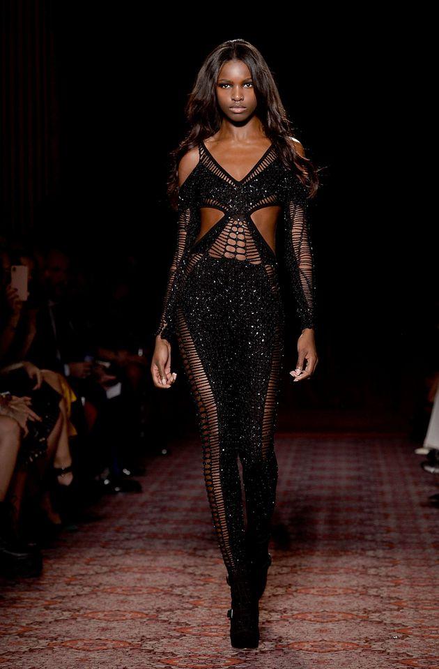 Leomie Anderson walks the runway at the Julien Macdonald London Fashion Week showon 18