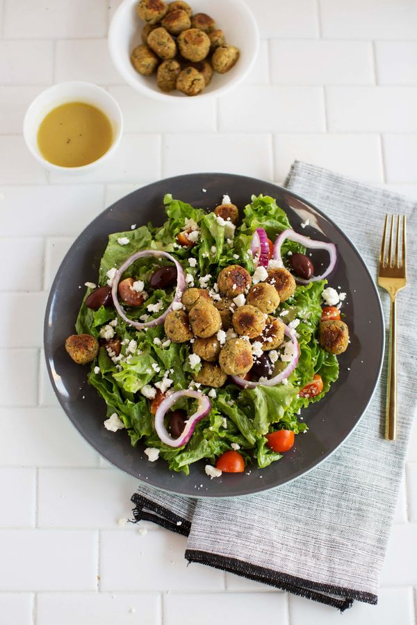 """<strong>Get the <a href=""""http://www.abeautifulmess.com/2016/11/baked-mini-falafel-salad.html"""" target=""""_blank"""">Baked Mini Fala"""