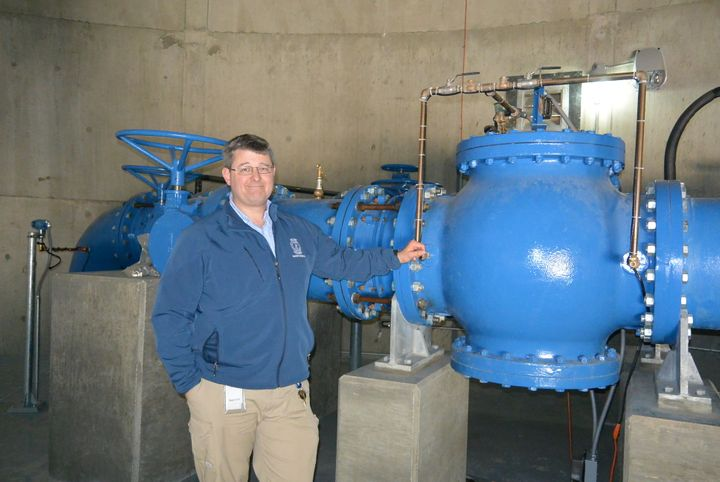 Jonathan Sherer of the Columbia, South Carolina, water department shows off a pump paid for with a $100 million municipal bon