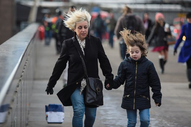 People in London battle against high winds caused by Storm
