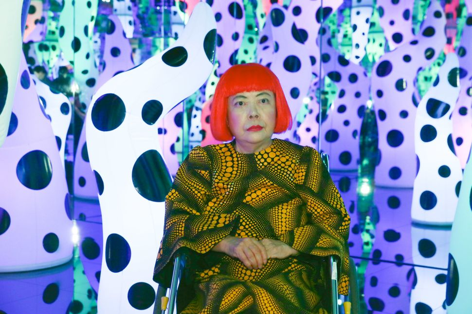 Yayoi Kusama at her own exhibition in 2013.