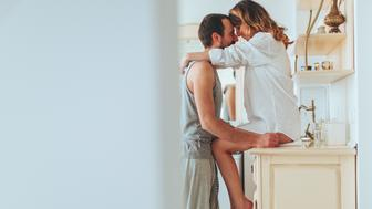 Loving couple is sharing their love and affection on Valentine's day in their rustic kitchen