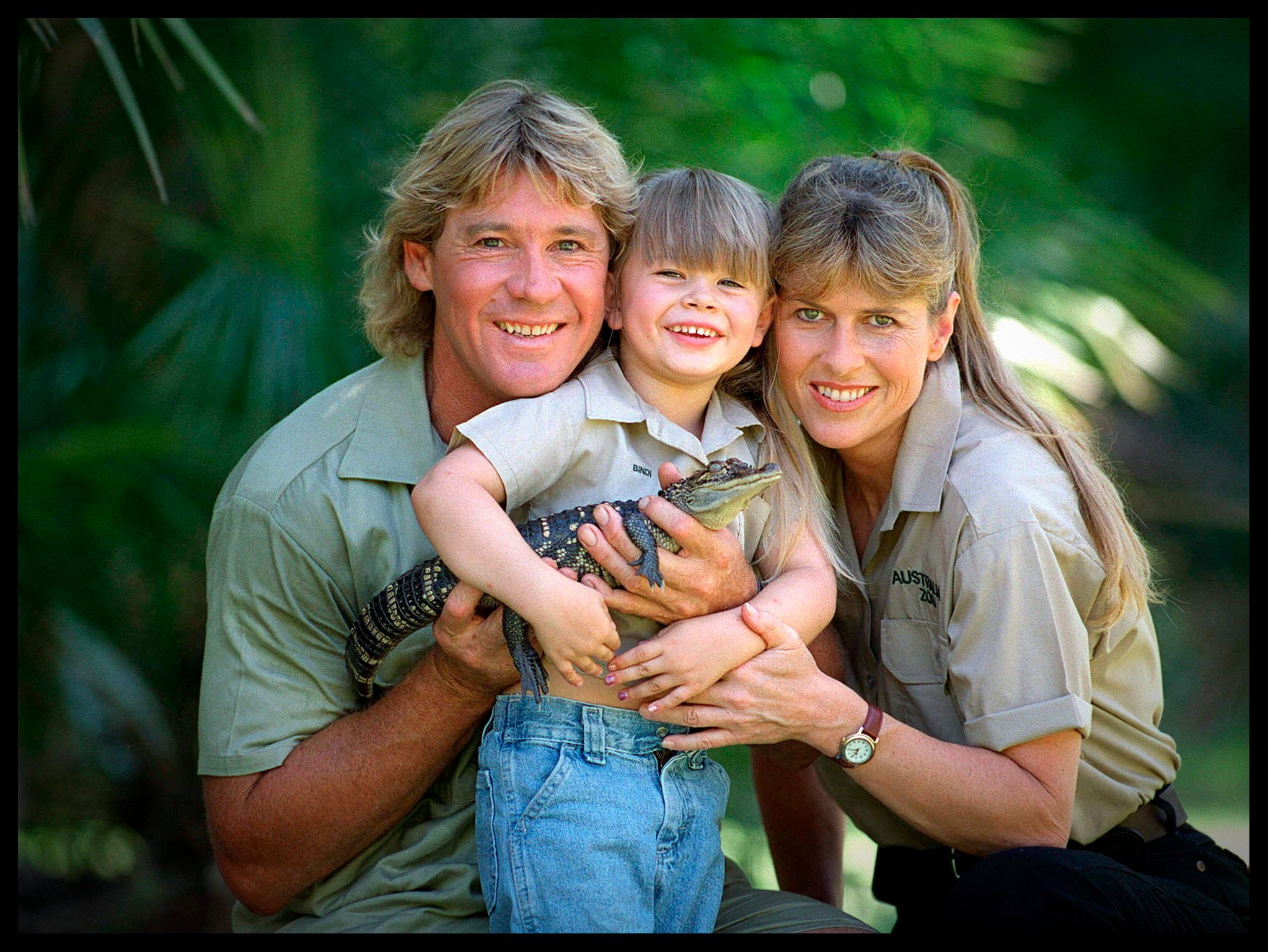 SUNSHINE COAST, AUSTRALIA - DECEMBER 14, 2002:  (EUROPE AND AUSTRALASIA OUT) 'Crocodile Hunter' Steve Irwin with his wife Terri Irwin, and daughter Bindi Irwin, and a baby crocodile at Australia Zoo in Queensland. (Photo by Newspix/Getty Images)