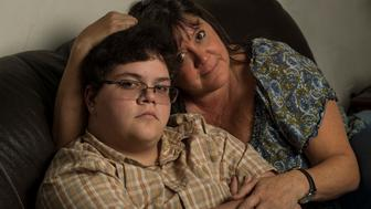 GLOUCESTER, VA --  AUGUST 21: Gavin Grimm, 17, left, is photographed with his mom Deirdre Grimm, in Gloucester, Virginia, on Sunday, August 21, 2016. The transgender teen sued the Gloucester County School Board after it barred him from the boys' bathroom. (Photo by Nikki Kahn/The Washington Post via Getty Images)
