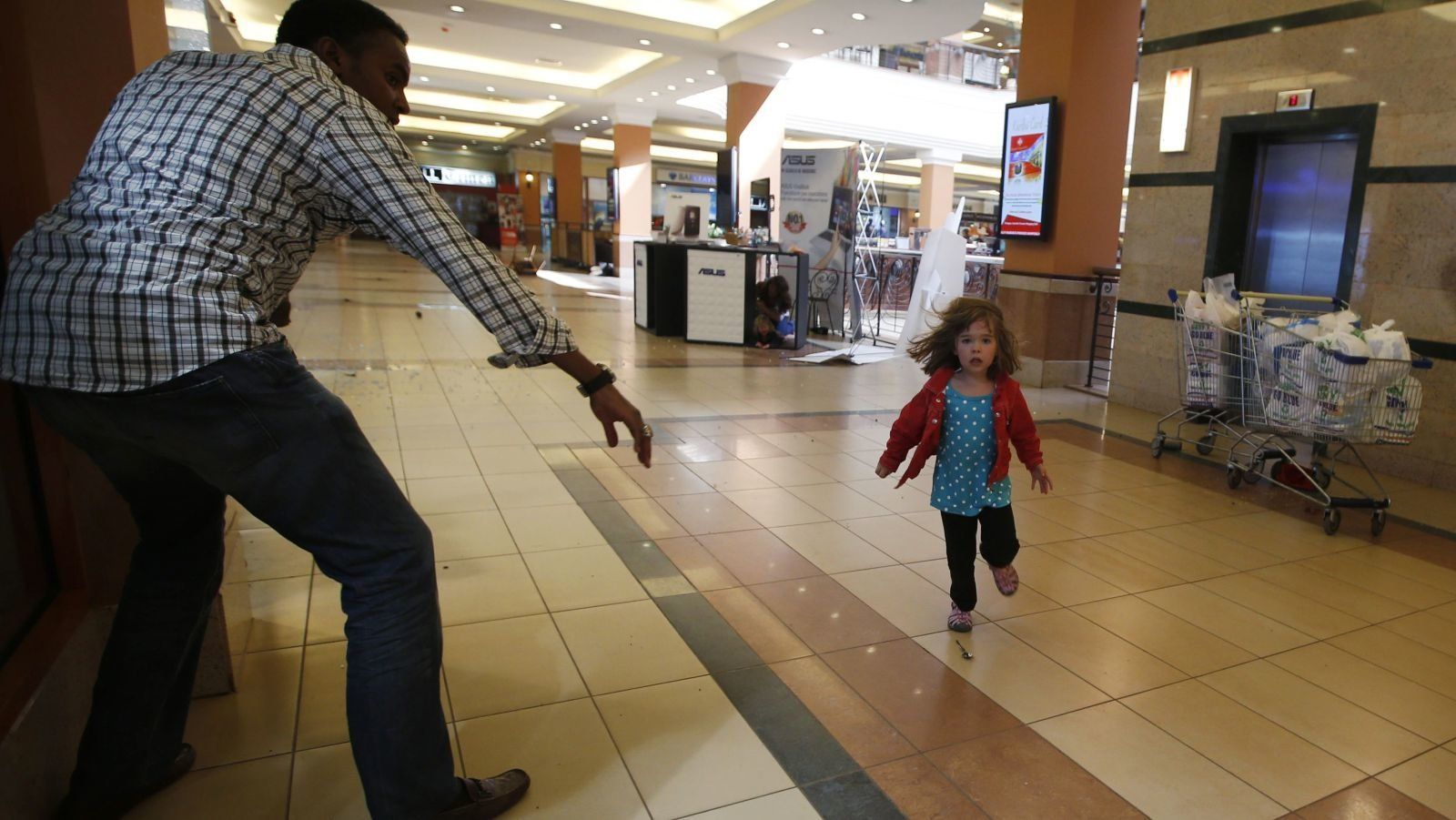 A child runs to safety during the attack on Westgate in 2013.
