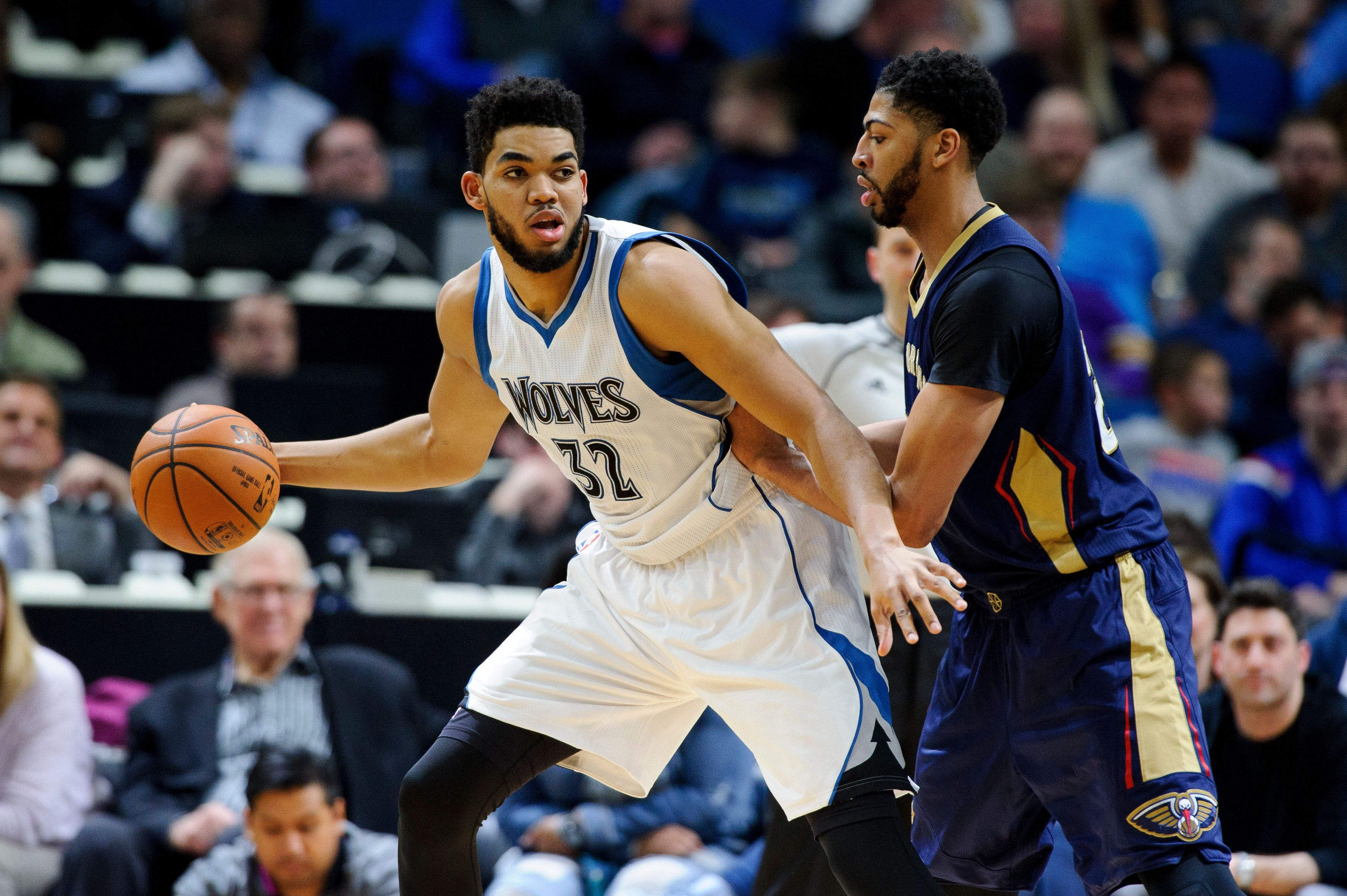 MINNEAPOLIS, MN - FEBRUARY 10: Anthony Davis #23 of the New Orleans Pelicans defends against Karl-Anthony Towns #32 of the Minnesota Timberwolves during the game on February 10, 2017 at the Target Center in Minneapolis, Minnesota. NOTE TO USER: User expressly acknowledges and agrees that, by downloading and or using this Photograph, user is consenting to the terms and conditions of the Getty Images License Agreement. (Photo by Hannah Foslien/Getty Images)