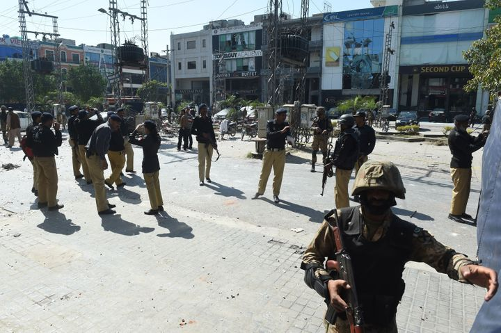 Pakistani soldiers and policemen cordon off the site of a bomb attack in Lahore on February 23, 2017.