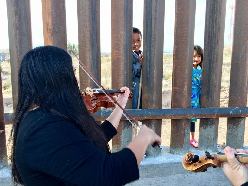 UTEP String Quartet provide early morning serenade to pajama-clad Mexican children across the border -near El Paso/Juarez