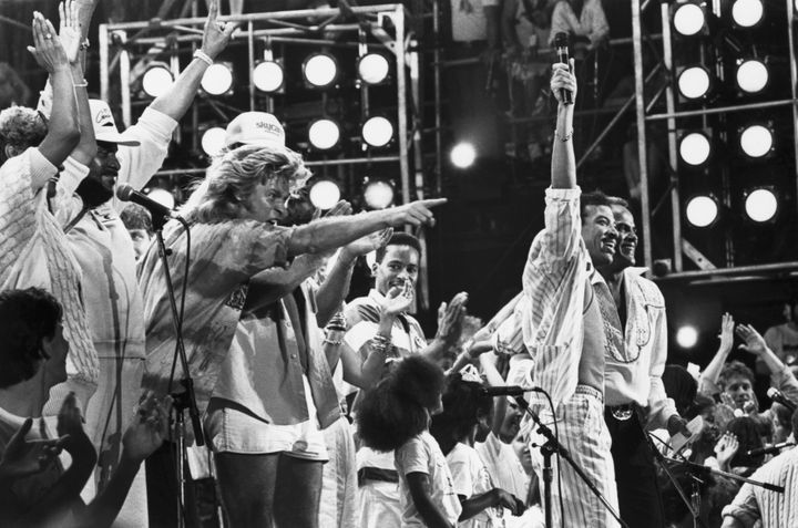 Lionel Richie and Harry Belafonte are joined by other performers at the Live Aid concert in Philadelphia as they all sing the