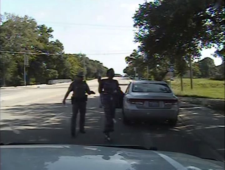 Texas state trooper Brian Encinia points a Taser as he orders Sandra Bland out of her vehicle, in this still image captured from the police dash camera video from the traffic stop of Bland's vehicle in Prairie View, Texas, U.S. on July 10, 2015.