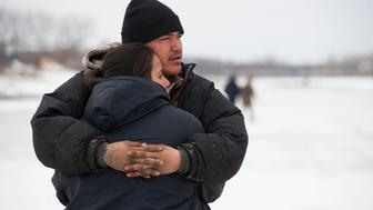 Ramona Three Legs 24 and Oscar High Elk 26  embrace after abandoning their possessions to avoid a police raid on the Oceti Sakowin camp in North Dakota on Feb 23 2017