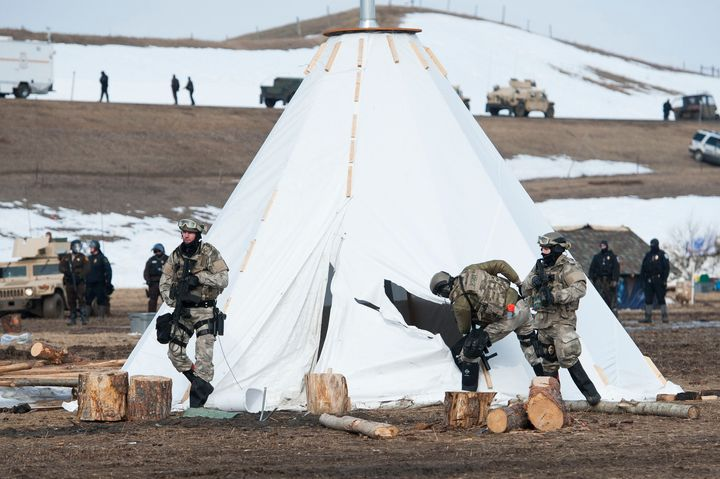 Officers inspect a tepee in while trying to clear Oceti Sakowin camp of several dozen protesters on Thursday.