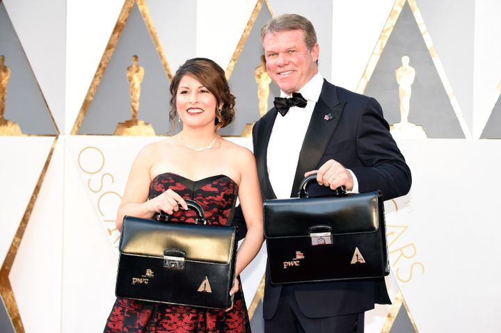 Martha Ruiz and Brian Cullinan walk the red carpet at the 2016 Oscars.