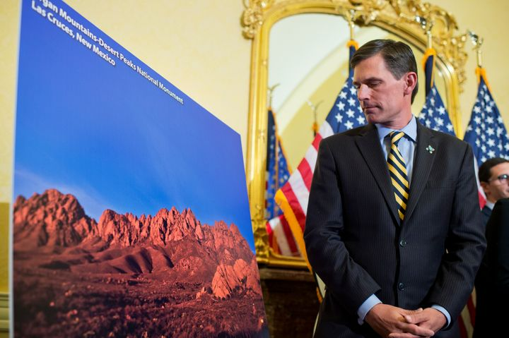 Sen. Martin Heinrich (D-N.M.) views a picture of Organ Mountains-Desert Peaks National Monument in New Mexico during a news c