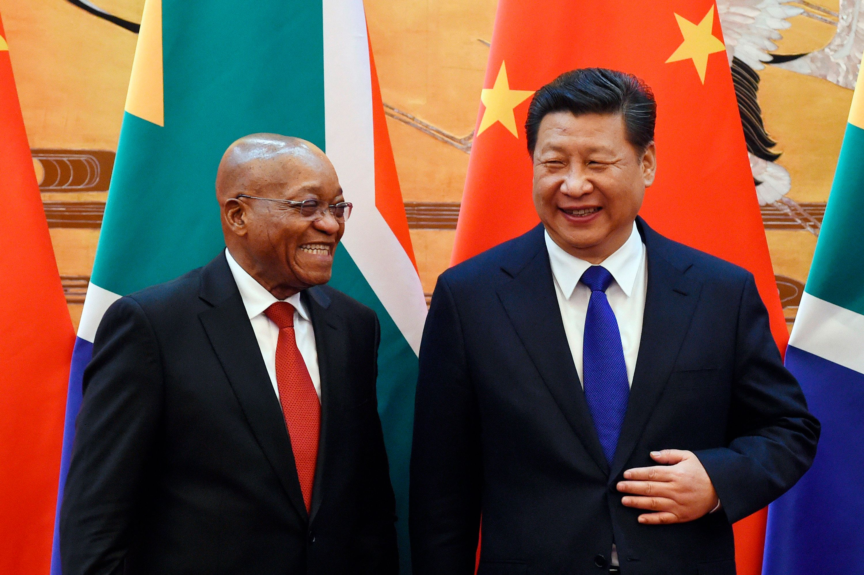 South African President Jacob Zuma (L) and Chinese President Xi Jinping share a laugh as they attend a signing ceremony at the Great Hall of the People in Beijing December 4, 2014. REUTERS/Wang Zhao/Pool (CHINA - Tags: POLITICS)