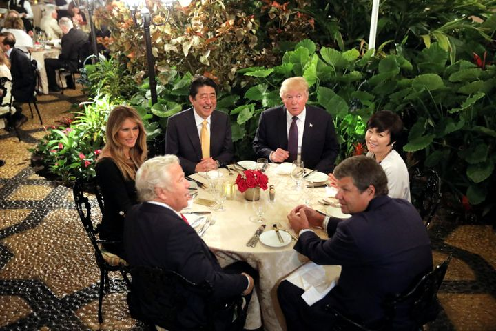 Donald Trump and his wife, Melania, with Japanese Prime Minister Shinzo Abe and his wife, Akie, at a dining room of Trump's M