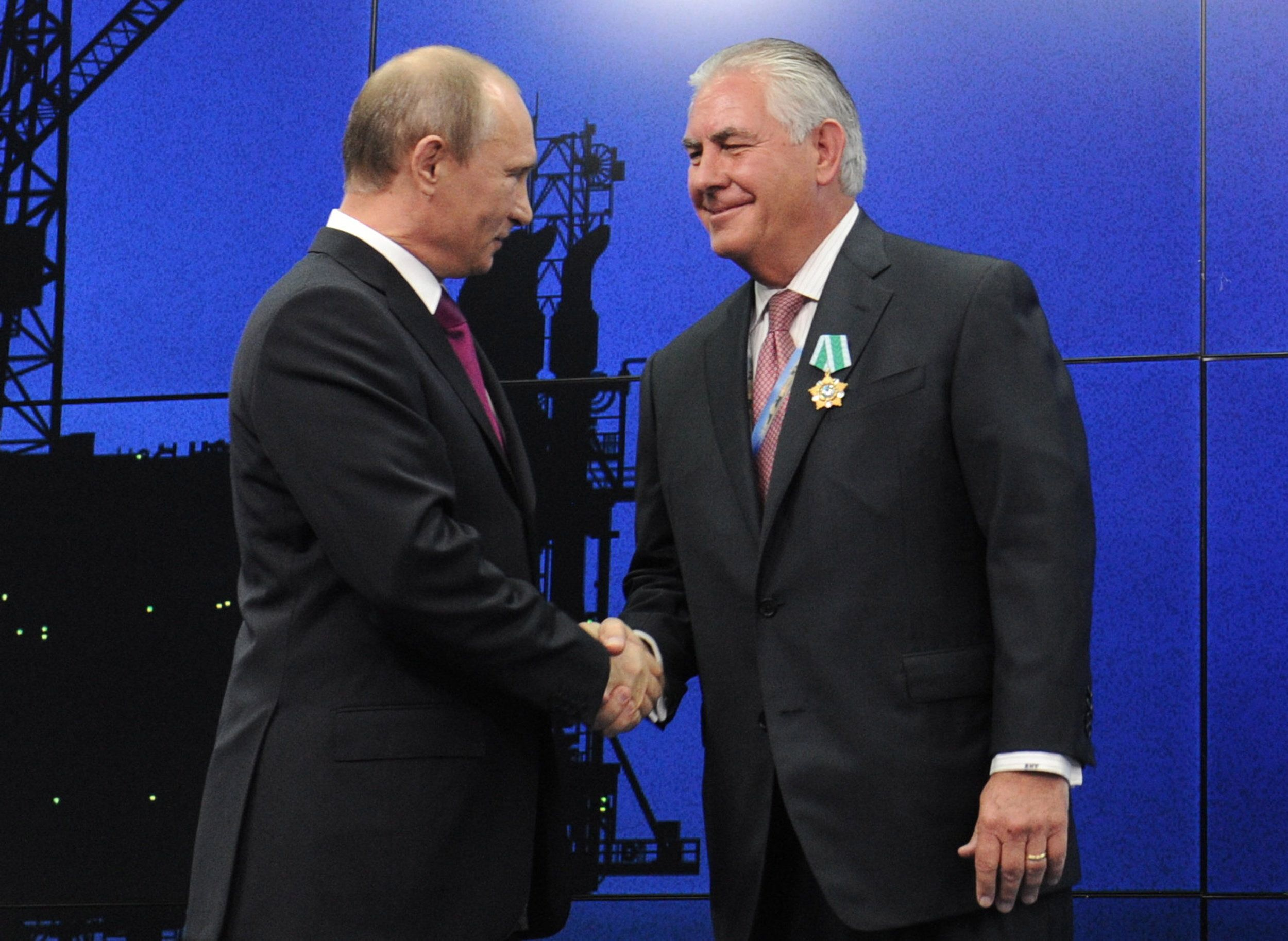 ST PETERSBURG, RUSSIA. Pictured in this file image dated June 21, 2013, are Russia's president Vladimir Putin and Exxon Mobil chairman Rex Tillerson (L-R) at an award ceremony for employees and chief executives of energy companies at the 17th St Petersburg International Economic Forum (SPIEF) at Lenexpo. Mikhail Klimentyev/Russian Presidential Press and Information Office/TASS (Photo by Mikhail Klimentyev\TASS via Getty Images)