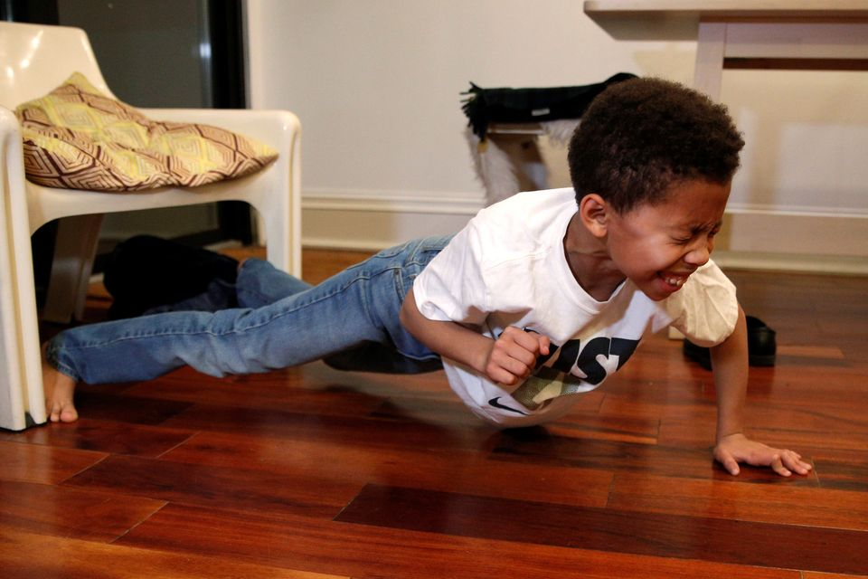 Penelope Ghartey does a one-handed push up at his home in Brooklyn, New York, December 13, 2016. Jodie Patterson's 3-year-old